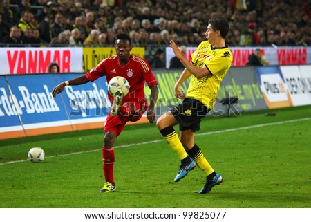 DORTMUND - APR 11: David Alaba against Robert Lewandowski (BVB) during a Bundesliga match between BVB Borussia Dortmund & FC Bayern Munich, final score 1-0, on Apr 11, 2012, in Dortmund, Germany.