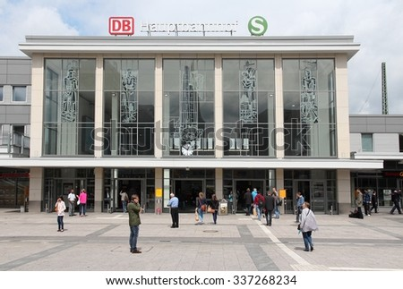 DORTMUND, GERMANY - JULY 16, 2012: People enter the main train station in Dortmund, Germany. The station exists since 1847 and serves at least 130,000 rides daily.