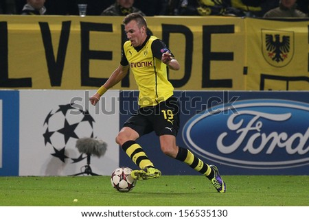 DORTMUND, GERMANY - OCT 1: Kevin Grosskreutz (BVB) during a Champions League match between Borussia Dortmund & Olympique de Marseille, final score 3-0, on October 1, 2013, in Dortmund, Germany. - stock photo