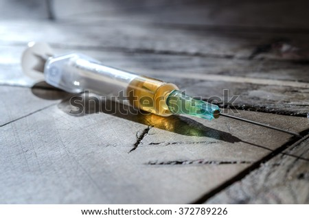 dose syringes scattered on the floor