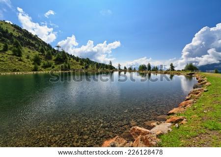 Doss dei Gembri small lake in Pejo Valley, Trentino, Italy - stock photo