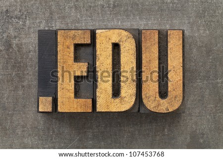 dot edu - internet domain for education in vintage wooden letterpress printing blocks on a grunge metal sheet - stock photo
