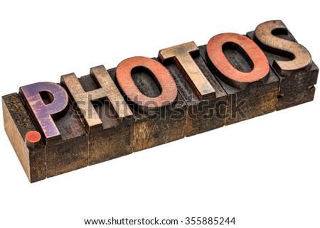 dot photos - photography website internet domain in vintage letterpress wood type - stock photo