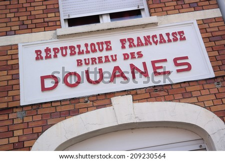 Douanes sign, a former customs building on the border of France and Belgium, Europe - stock photo