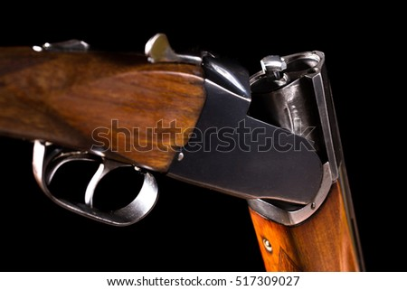 Double-barreled shotgun on a black background