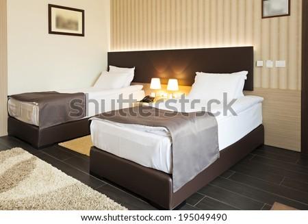 Double bed bedroom interior - stock photo