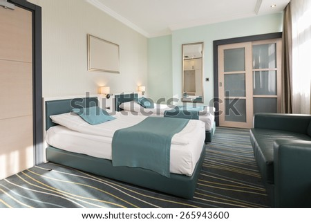 Double bed hotel room in the morning - stock photo