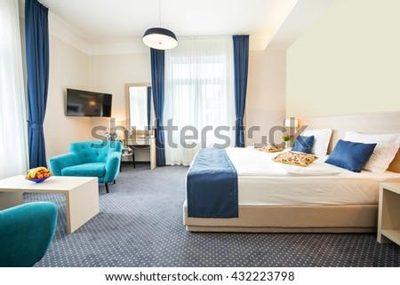Double bed hotel room interior - stock photo