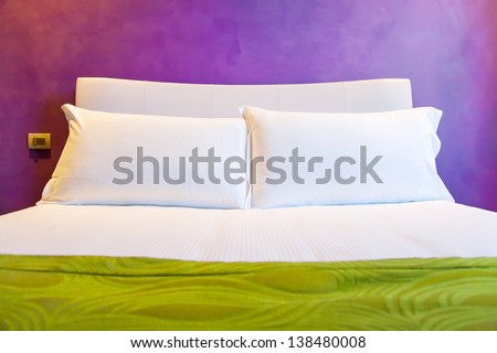 Double bed in a hotel - stock photo