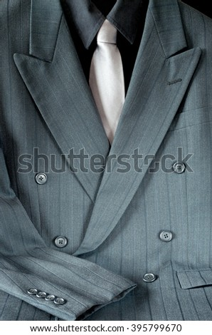 double-breasted pinstripe gray suit or mens sport jacket and shirt with necktie - stock photo