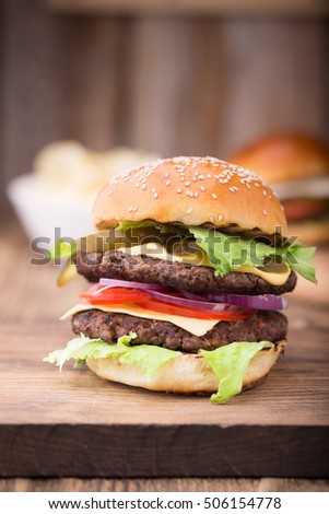 Double burger on wooden board. Close up