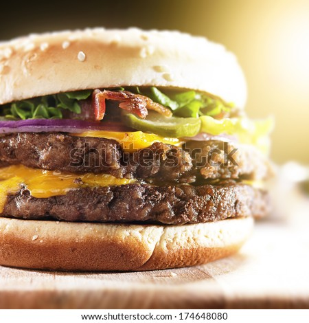 double burger with bacon and melted cheese close up - stock photo