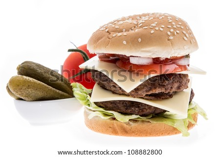 Double Burger with ingredients in the background isolated on white - stock photo