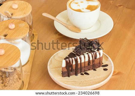 Double chocolate cake and brownie on top serve with hot latte - stock photo