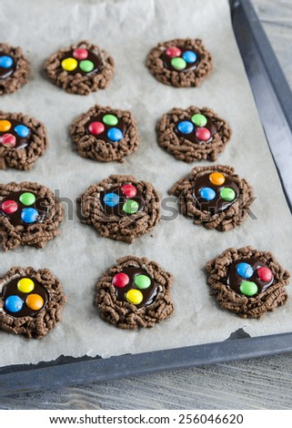 Double chocolate chip cookies with colorful candy - stock photo