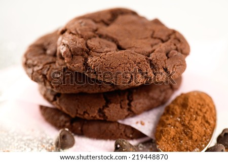 Double dark chocolate cookies, sugar sprinkles, cocoa powder and chocolate chips.  - stock photo