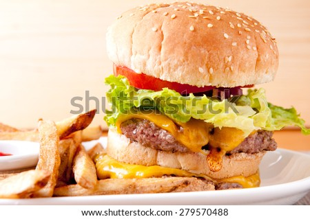 double decker cheeseburger with fresh french fries - stock photo