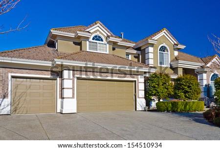 Double doors and one door garage. North America. - stock photo