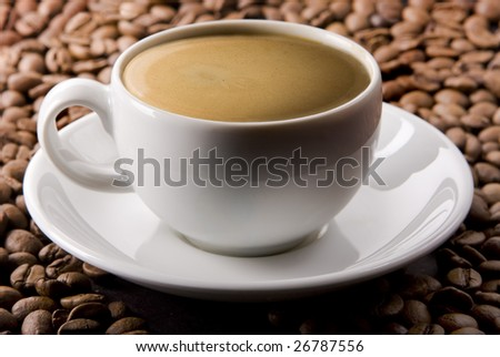 Double espresso on coffee beans
