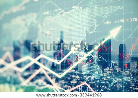Double explosure with businesss charts and financial district of megapolis city - stock photo