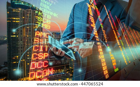 Double exporsure of Businessmen using touchpad,city scape and network connection concept,Investment concept  - stock photo