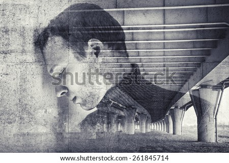 Double exposure abstract conceptual photo collage, sad stressed young man with concrete wall and industrial urban background - stock photo