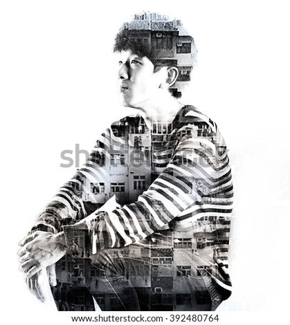 double exposure asian sad man and city buildings - stock photo