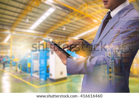 Double exposure authorities Quality Inspector wearing magnifying glasses inspecting a small manufactured part and factory - stock photo