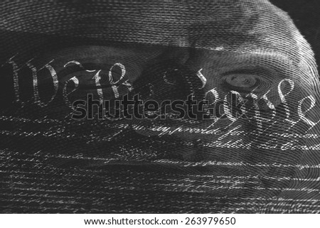 Double exposure black and white US constitution We the People with one hundred dollar bill - Finance and government concept - stock photo
