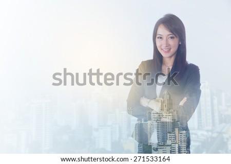 double exposure businesswoman has city,plane,stock exchange  - stock photo