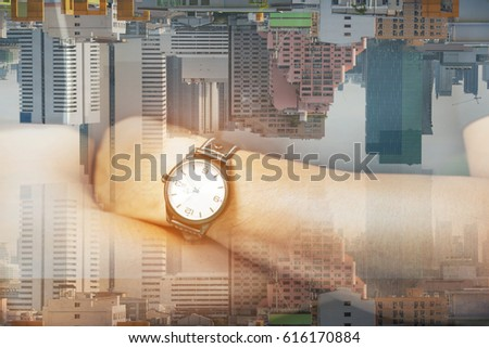 Double Exposure, Close up Engineer wearing watch and cross one's arm and building in the city. Concept : Time and building.