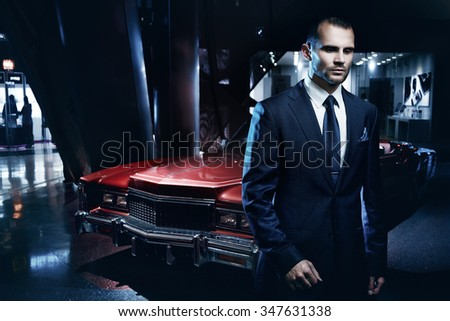 Double exposure concept, serious man in a business suit, dark background, backlight blue tones - stock photo