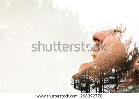 double exposure creative portrait of a young man, nature