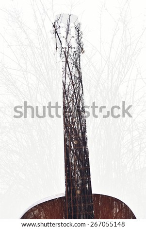 double exposure guitar in tree branch. nature music - stock photo