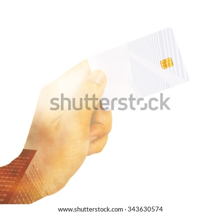 Double exposure. Hand hold credit card on metro city building background. - stock photo