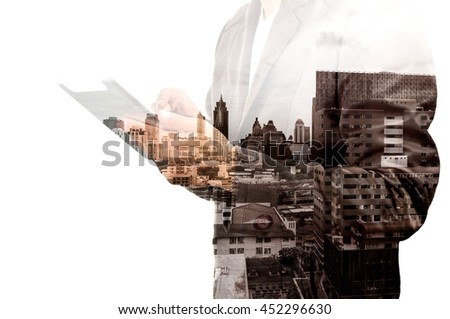 Double Exposure Hand of Businessman and City Building as Digital Business Technology Concept - stock photo
