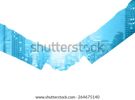double exposure handshake between businessman on a city background - stock photo