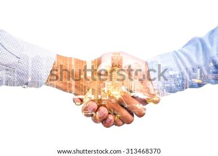 double exposure handshake on a city background - stock photo