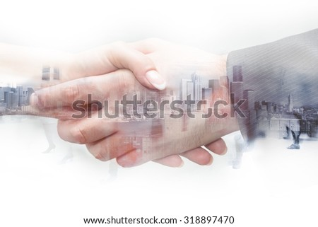 double exposure handshake woman and man on a city background - stock photo
