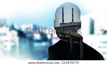 double exposure image of man silhouette, nuclear power station and city - stock photo