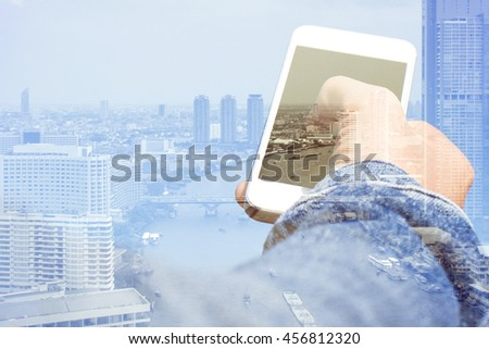 Double exposure image of smart phone with cityscape background,Communication technology concept - stock photo