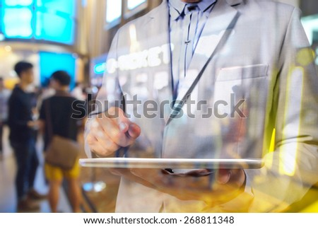 Double exposure manipulation of Business Man using Tablet and blur Background of Theatre e-ticket system as online booking concept.  Selective focus on Tablet in male hand. - stock photo