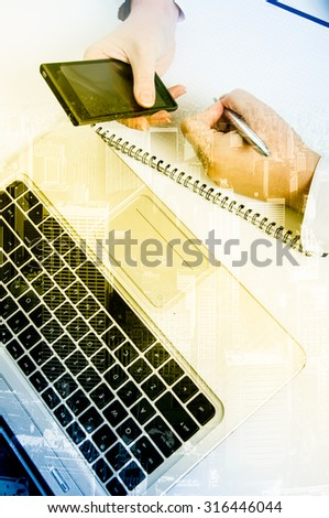 Double exposure modern technology as concept with laptop and phone.