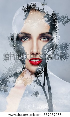 Double Exposure of a beautiful young woman with bright makeup and a tree on a gray background - stock photo