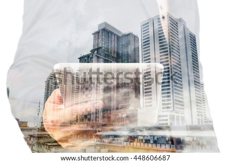 Double exposure of a businessman and a city using a tablet over white background as Business Technology Concept
