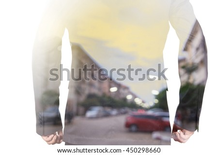 Double exposure of a businessman and Blur Background of Modern Town at Sunrise as Modern Life concept - stock photo