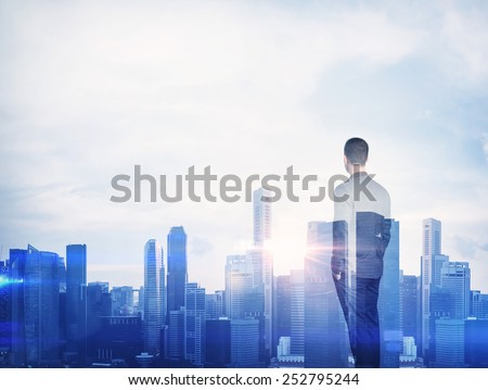 Double exposure of a businessman and megalopolis - stock photo