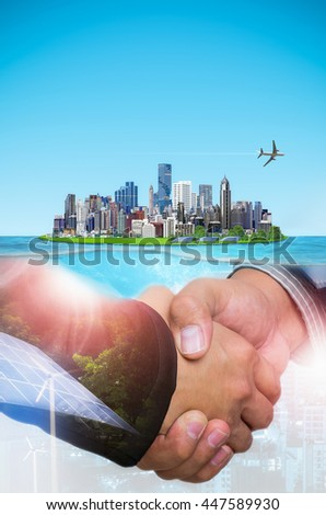 Double Exposure of a businessman handshake on the background the island city is friendly to the environment, the concept of green energy deal, agreement green energy. - stock photo