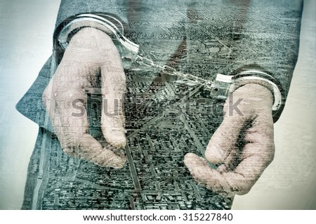 double exposure of a handcuffed man and a tract housing development and a developing land, symbolizing the crime of property speculation - stock photo