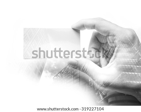 Double exposure of a man's hand with business card, Black and white